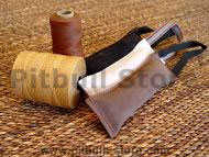 Dog bite tug made of leather with handle